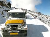 Car stuck in snowfall poster