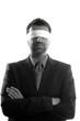 Blindfolded businessman over white background