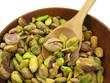 Pistachios kernels in wooden dish