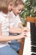 Cute Kids Playing the Piano