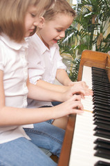Cute Kids Playing the Piano