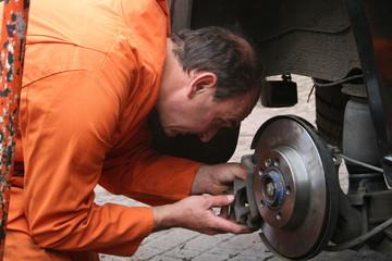 mechanic changing brake disc