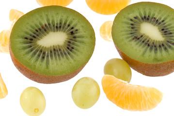 fruits, kiwi parts and mandarin segments, vine, on white
