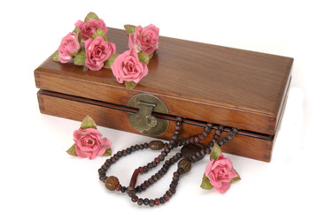 Wooden box with roses and necklace