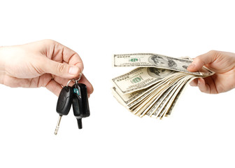 Hand with money and car keys