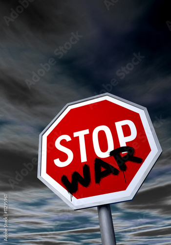 """STOP"" sign with graffiti against the night sky"