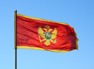 Flag of Montenegro on a blue sky