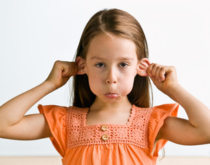 Young girl pulling ears