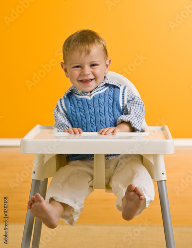 Young boy in highchair