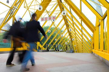 Yellow corridor, spheres and people