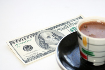 cup hot coffee and dollars