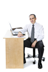Businessman at his desk on white background