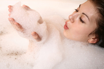 The girl takes a bath.