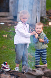children near campfire poster
