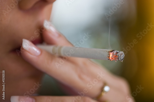 Smoking woman with a cigarette - 11310558