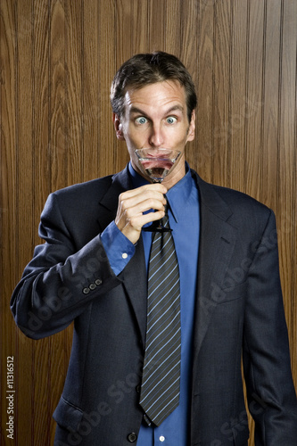 Businessman drinking a cocktail