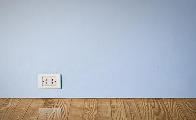 electric outlet in old wall.