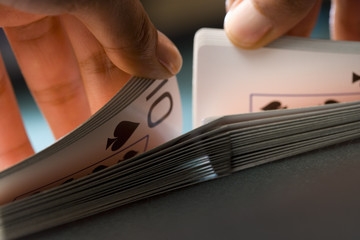 Close up of manճ hands shuffling playing cards