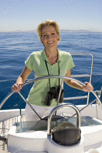 Woman steering boat