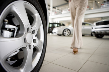 Woman walking in new car showroom
