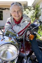 Senior woman posing on motorcycle