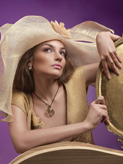 Woman in a hat. A female model wearing a big floppy hat.