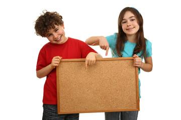 Kids holding noticeboard isolated on white background