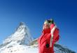 Woman skiing over Matterhorn