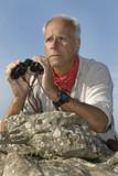 Explorer with is binocular looking for adventure poster