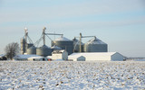 Farm with Grain Bins in the Snow