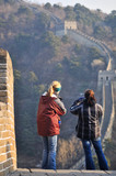 visitors standing on the great wall of china poster