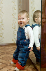 Small smiling baby with mirror