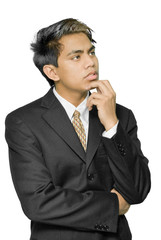 Pensive young Indian businessman