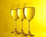 Three glasses on yeloow background