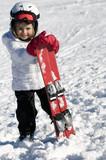 Fototapety Little girl on ski