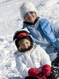 Little girl with mother  on winter vacation poster