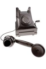 Old black telephone isolated on white background