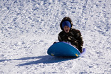 Little Boy Sledding down the Hill