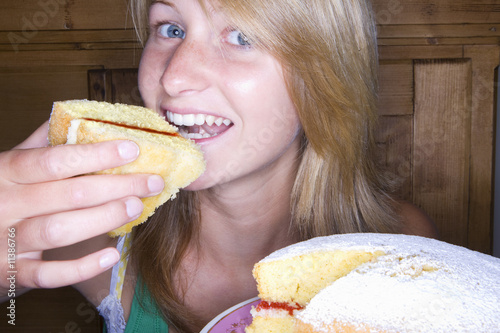 Close up of girl eating cake