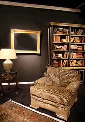 Detail of classic interior with books and chair