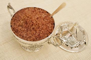 Brown sugar in silver sugar bowl.