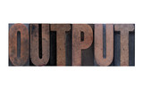 the word 'output' in old ink-stained wood type