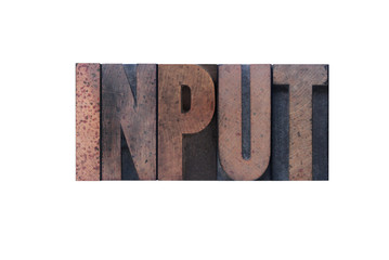 the word 'input' in old ink-stained wood type