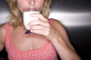 Close up of woman drinking glass of milk