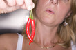 Close up of woman holding spicy peppers