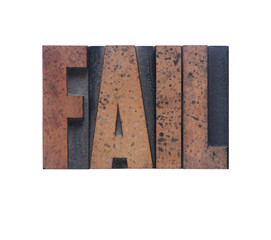 the word 'fail' in old ink-stained wood type