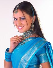 Indian girl with heavy jewelery