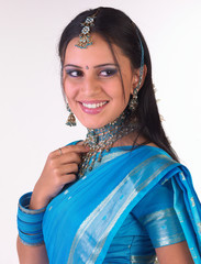 Smiling young girl in blue sari