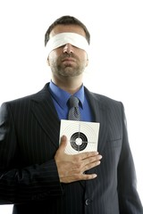Blindfolded businessman with target over white