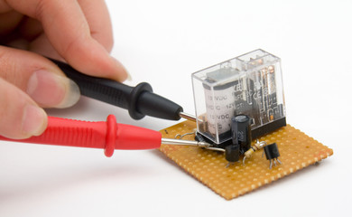 Testing circuit board with multimeter terminals